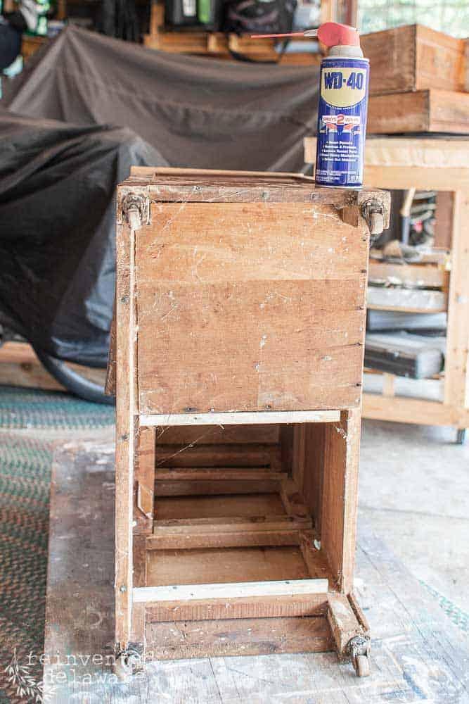 underside of antique washstand before makeover