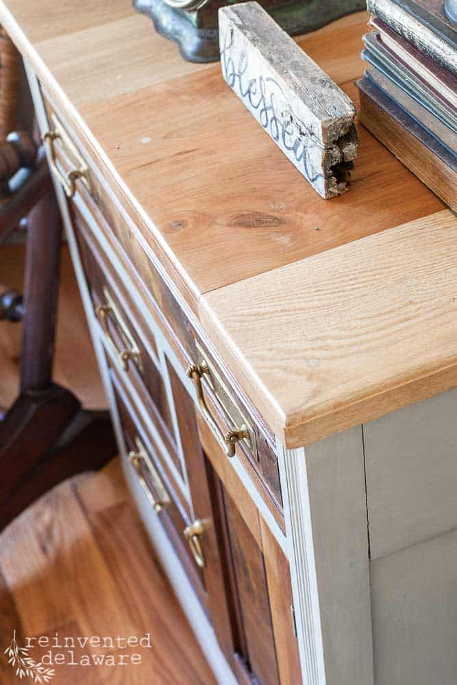 close up of reclaimed lumber top of an antique washstand redo