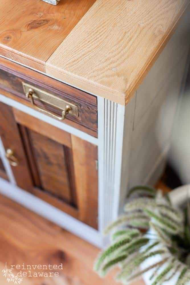 close up detail of wood top on restored antique washstand