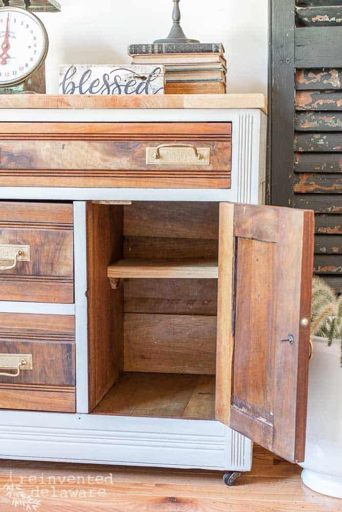 inside cabinet area of an antique washstand that has been madeover