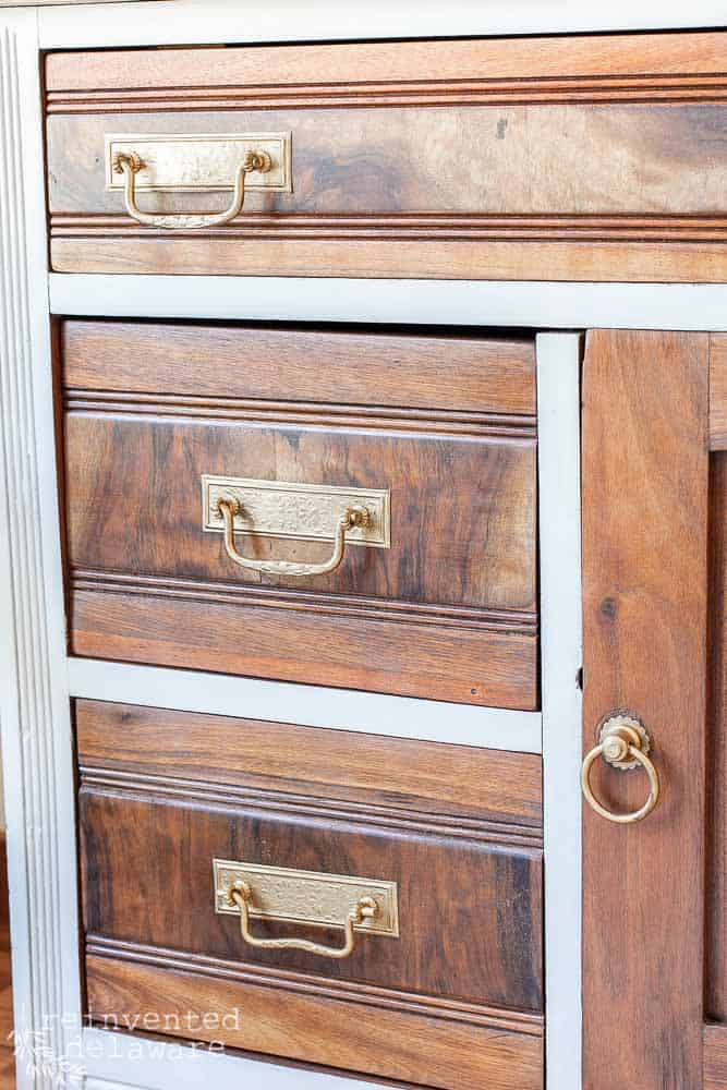 antique washstand makeover showing drawer pulls that have been restored with Rub n Buff