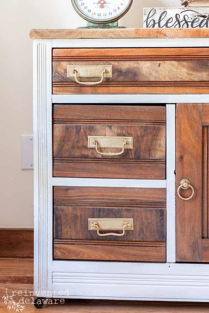 shot highlighting the three drawers of a restored antique washstand