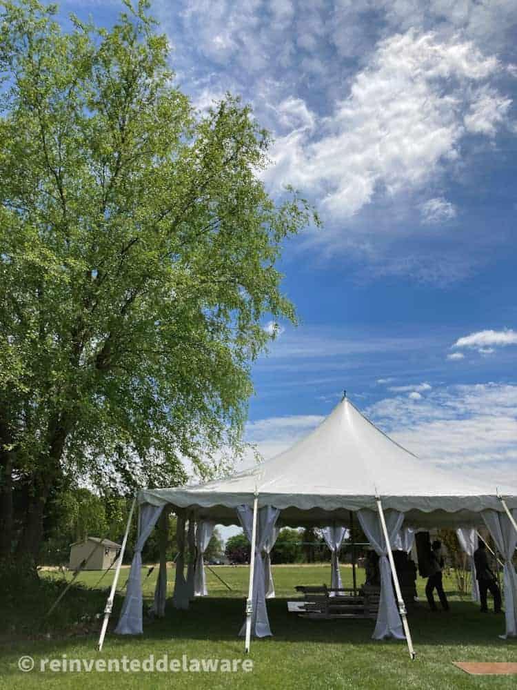 large yard tent ready for backyard wedding
