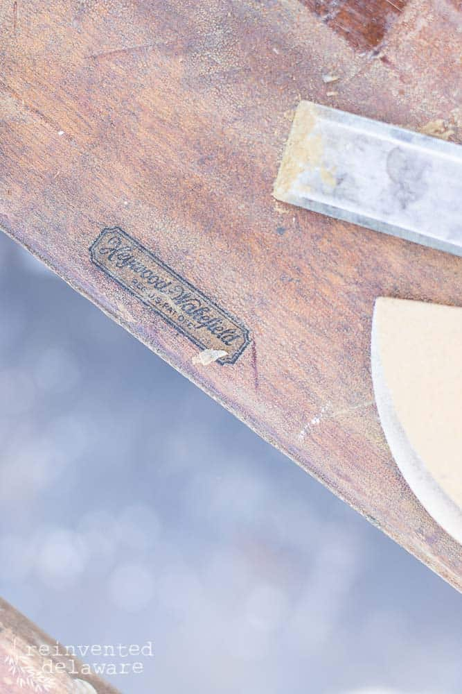 close up of makers mark Heywood Wakefield on backside of antique school desk
