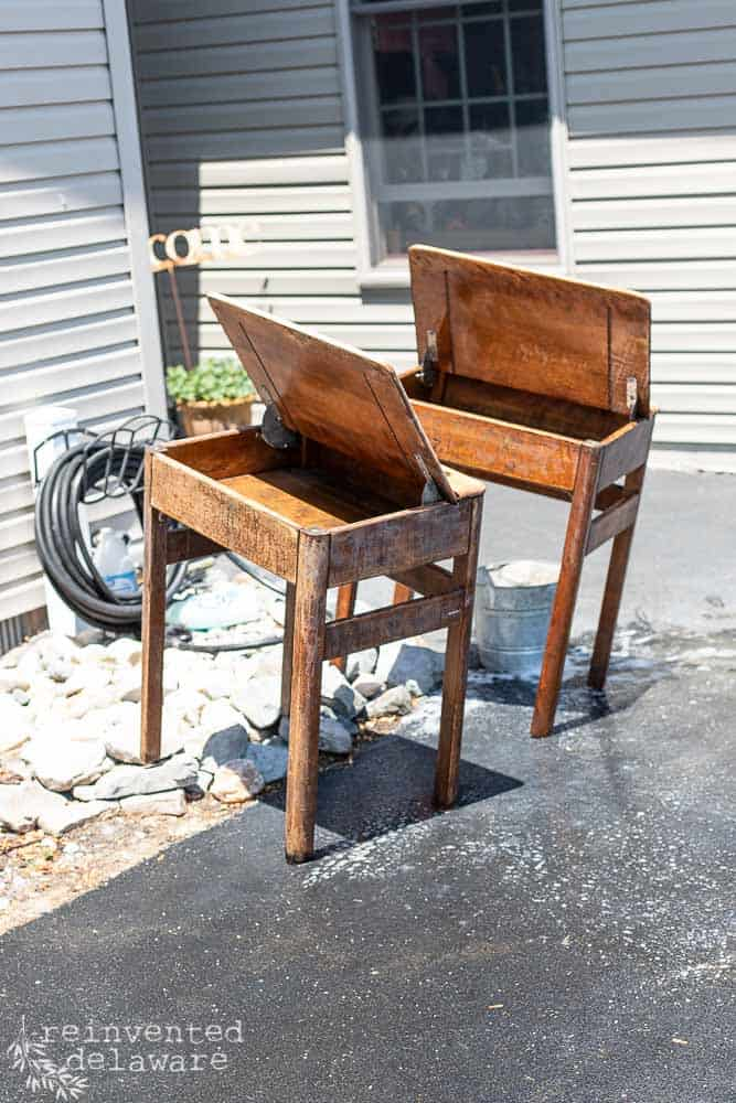 antique desks drying in sun after thorough scrubbing