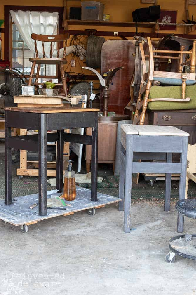 pair of antique school desks that have been painted, one with hemp oil finish, one without