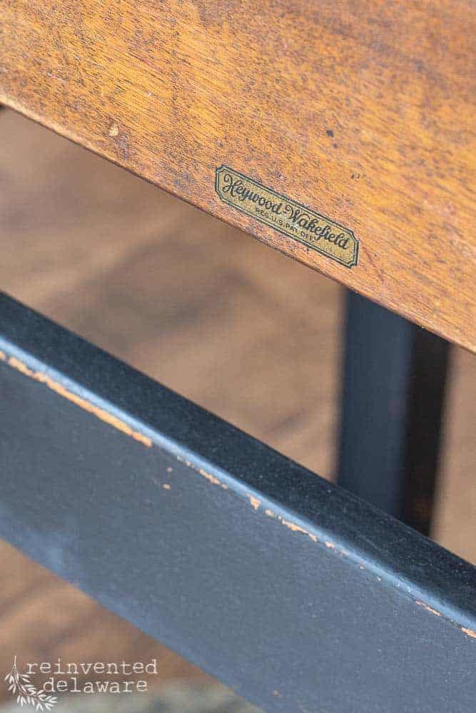 close up of makers mark label Heywood Wakefield on school desk