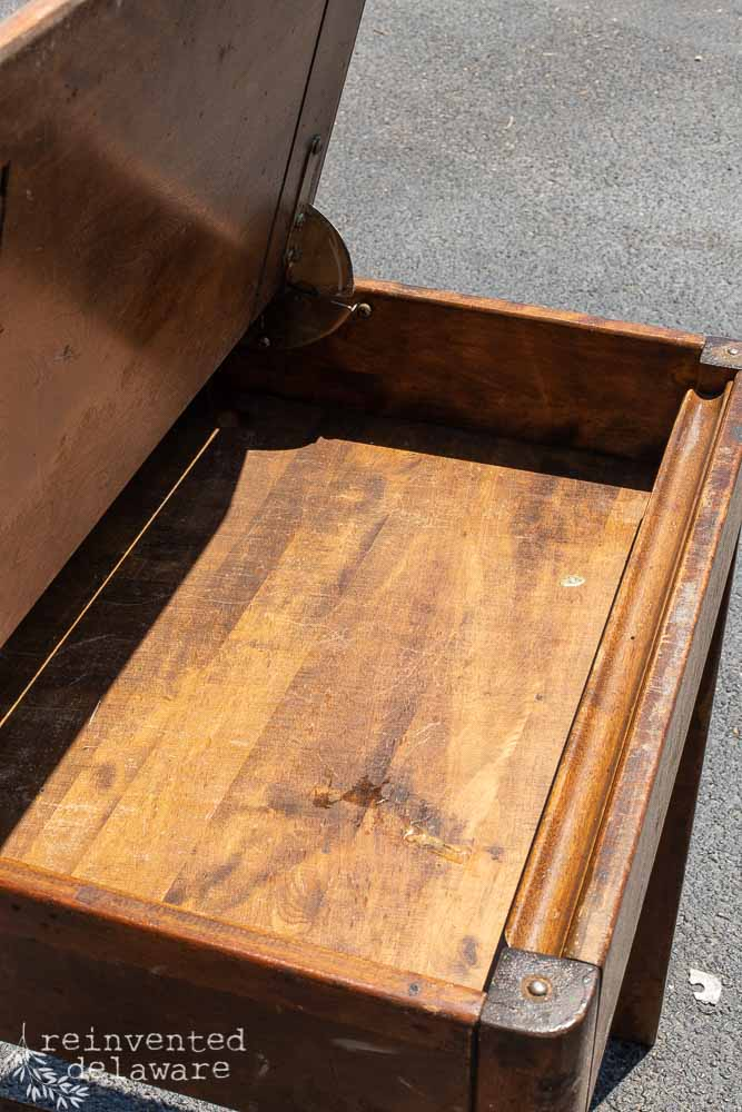inside of Heywood Wakefield desk showing damage, old gum and pencil slot