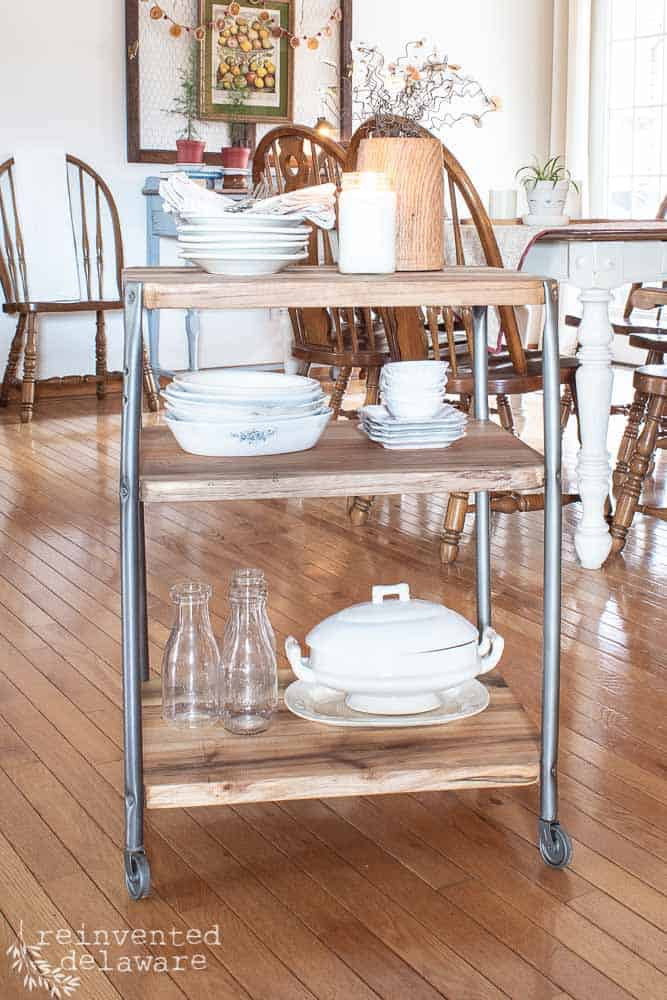 repurposed school cart with ironstone dishes on shelves