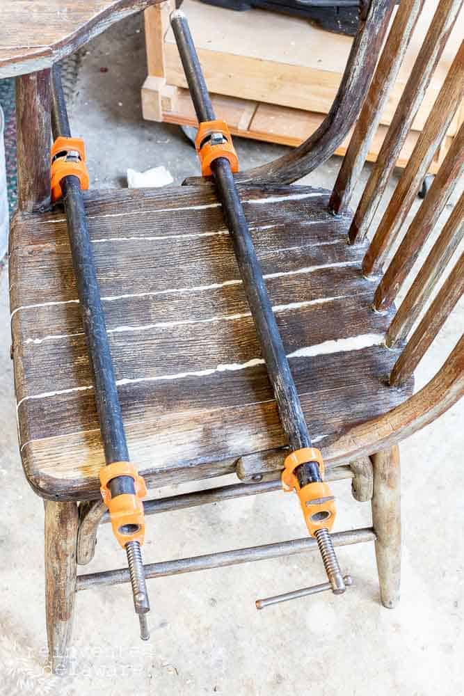 bar clamps on broken chair seats during easy chair seat repair project