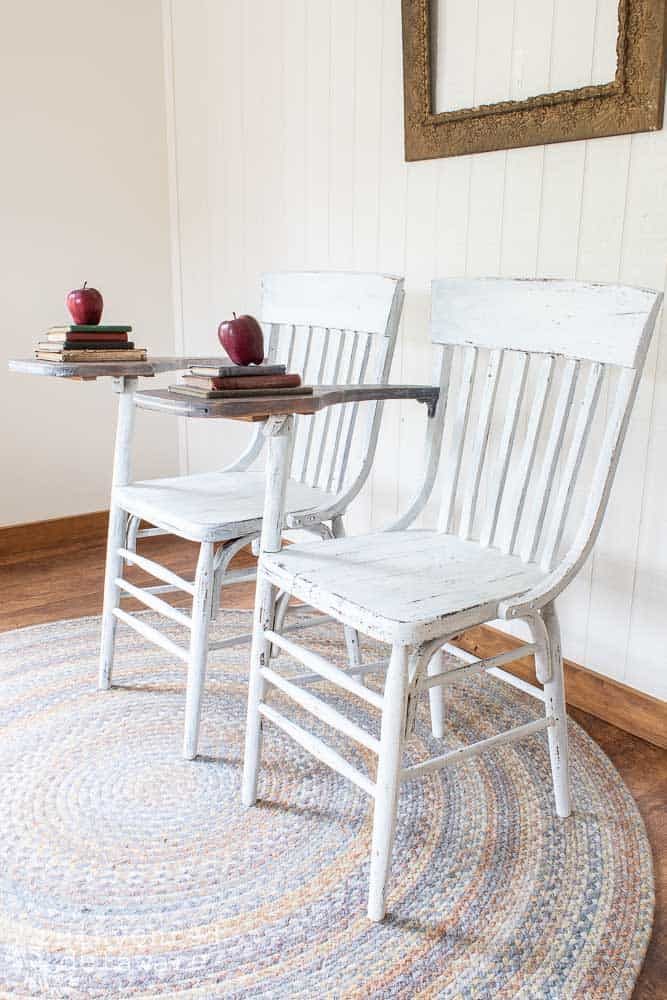 side view of pair of desk chairs highlighting the farmhouse white milk paint