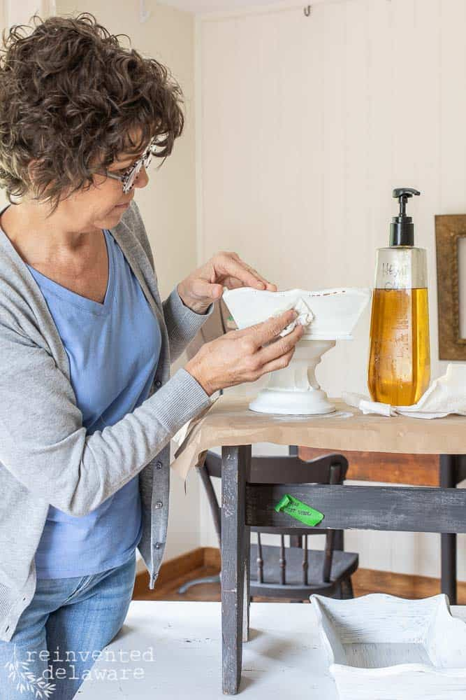 lady applying Miss Mustard Seed Hemp Oil to upcycled wooden tray makeover