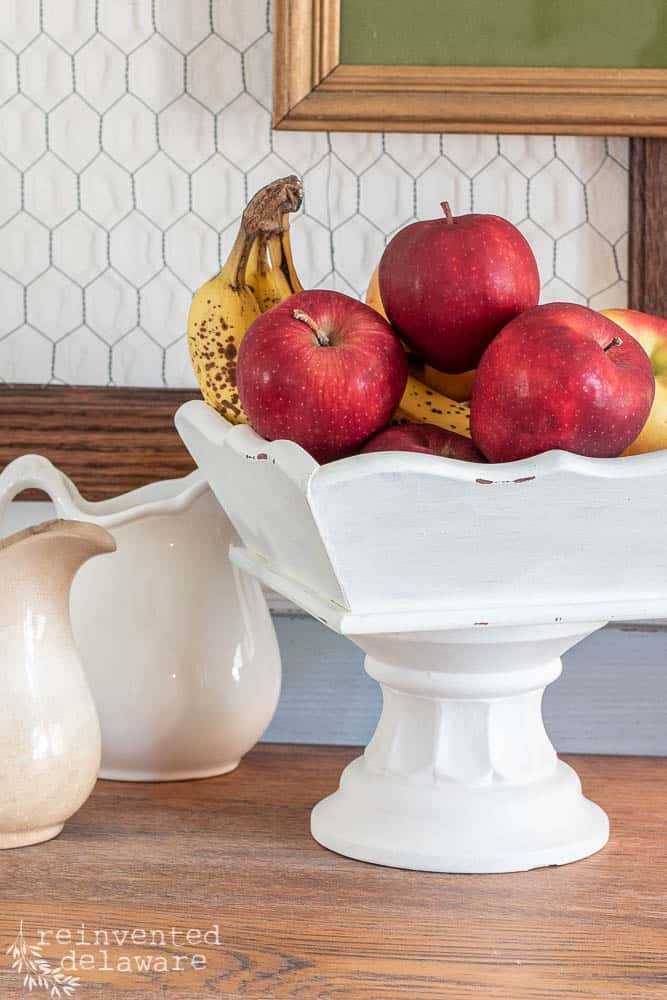 close up shot of upcycled wooden tray with fruit inside and showing chippy milk paint finish