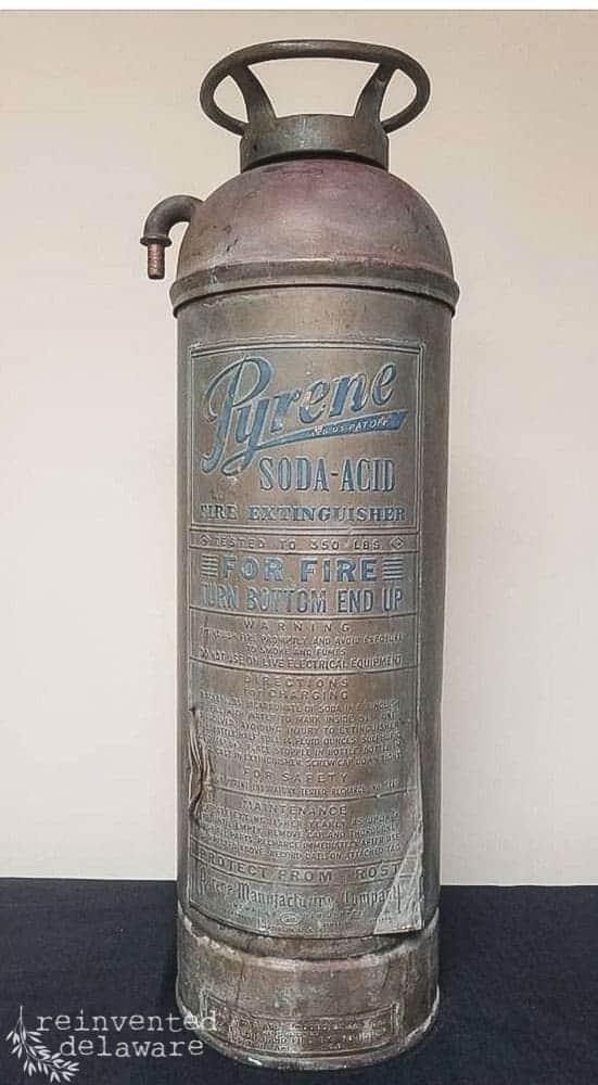 vintage and antique fire extinguisher before restoration