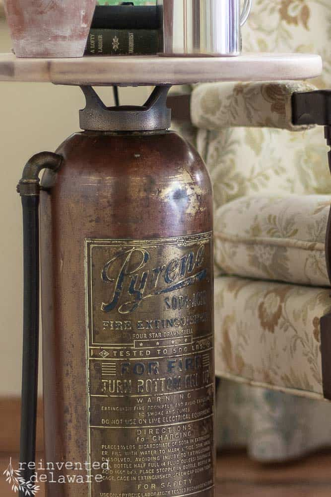 close up of label on vintage fire extinguisher with text about the brand Pyrene and other important information
