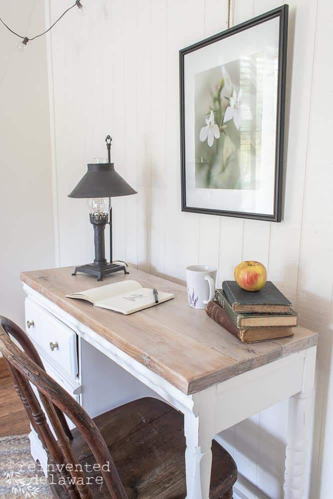 side view of desk showing the reclaimed lumber top that was white waxed for desk makeover ideas blog post
