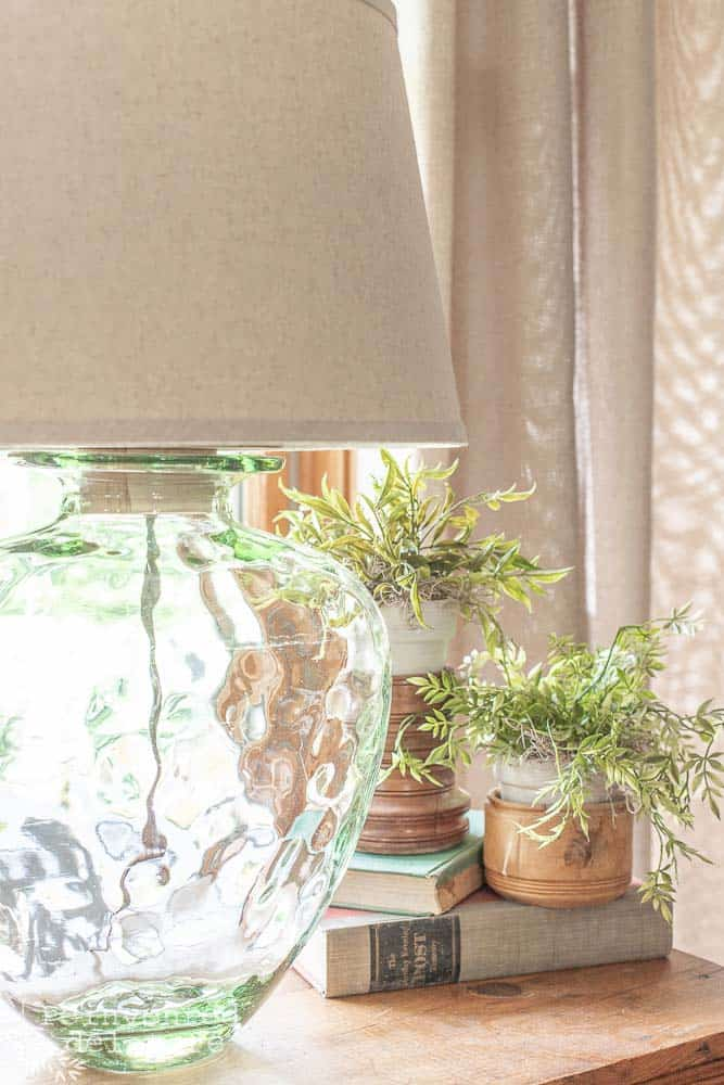 side view of upcycled glass jar lamp diy project with greenery