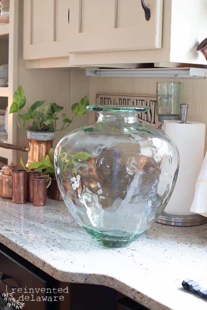 thrifted green glass jar sitting on kitchen counter