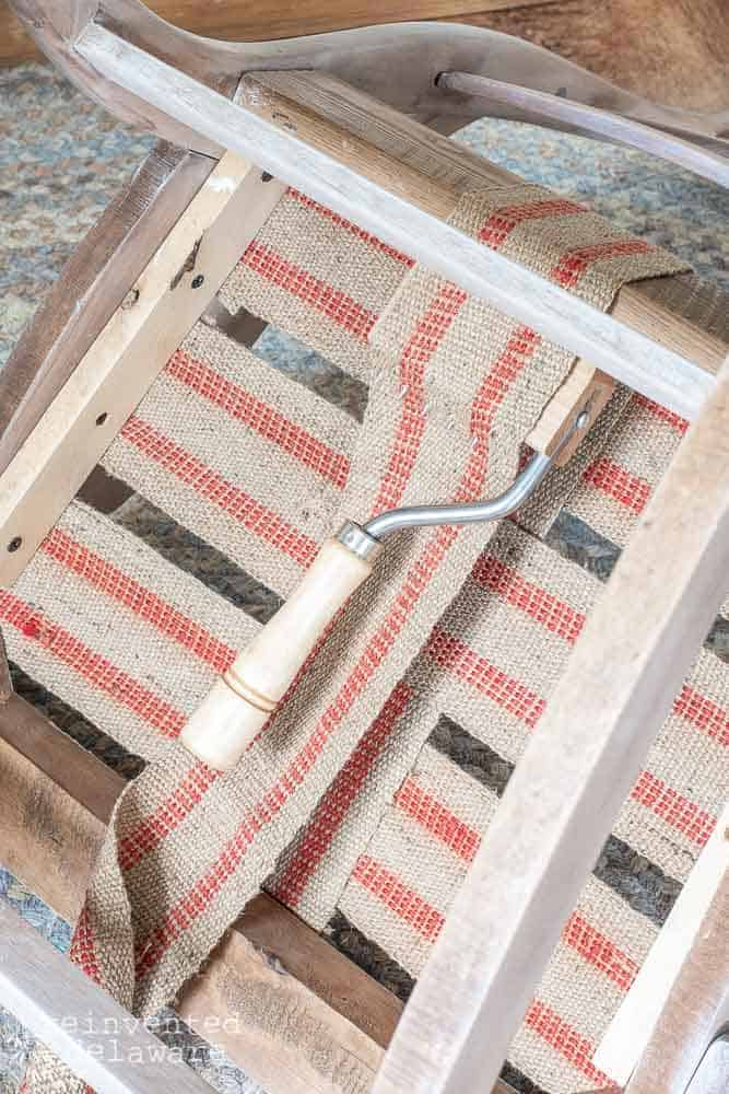 webbing stretcher being used to stretch upholstery webbing