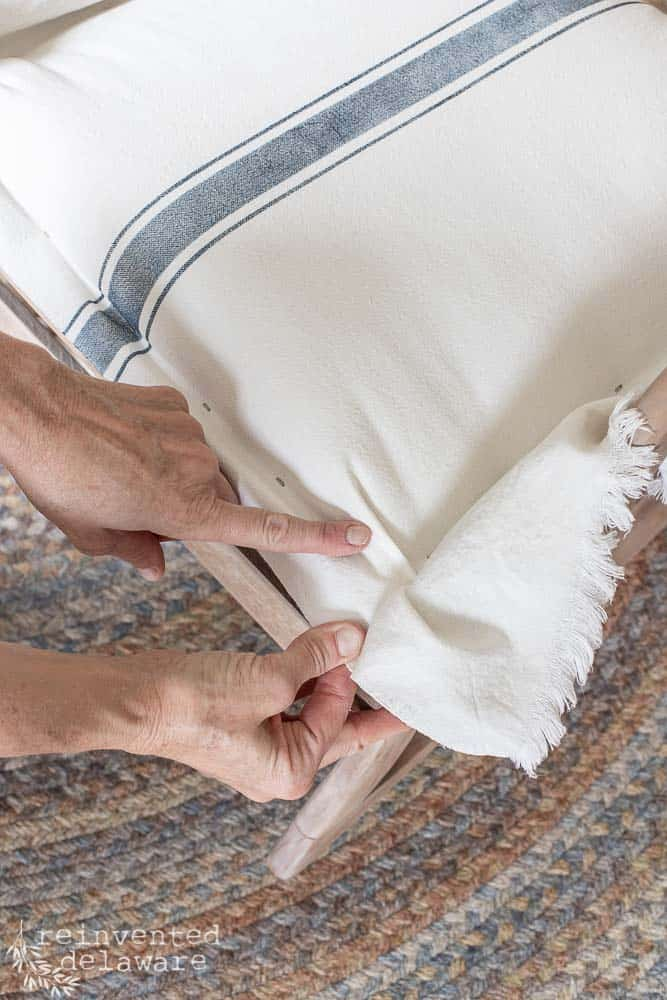 lady pointing to pleat on rocking chair covering ideas tutorial