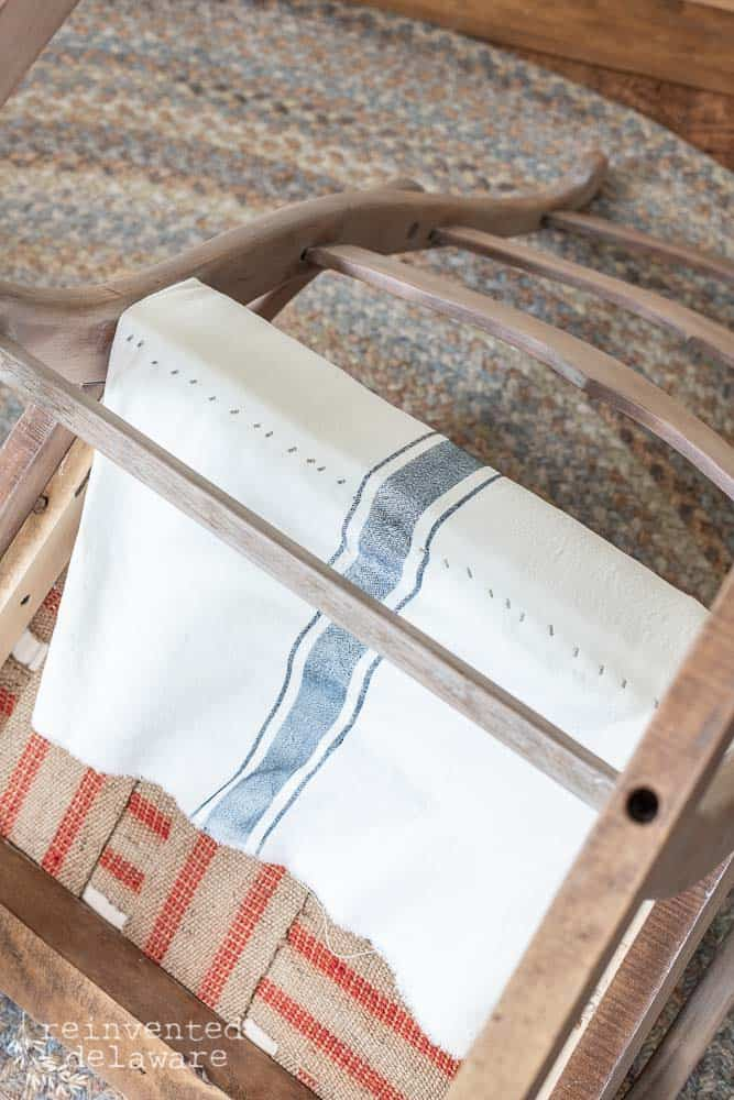 detail of fabric stapled down on underside of recovered rocking chair