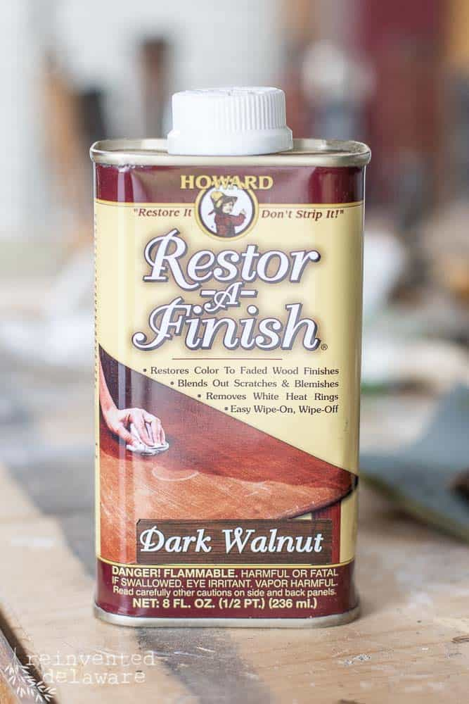 close up of Restor-a-Finish container in dark walnut