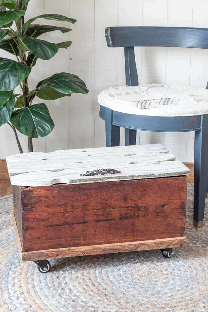 wood tool box repurposed with picket fence lid and casters as a storage container