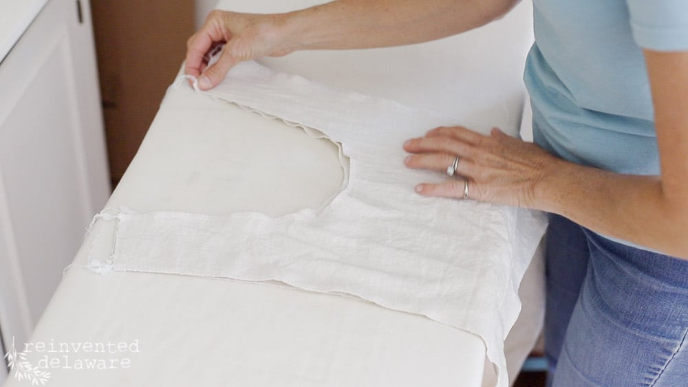 lady at ironing board prepping front facing and front of apron showing step by step how to sew an apron
