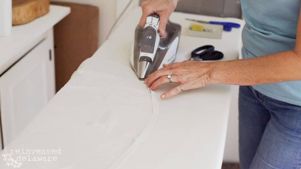 lady ironing hem on apron