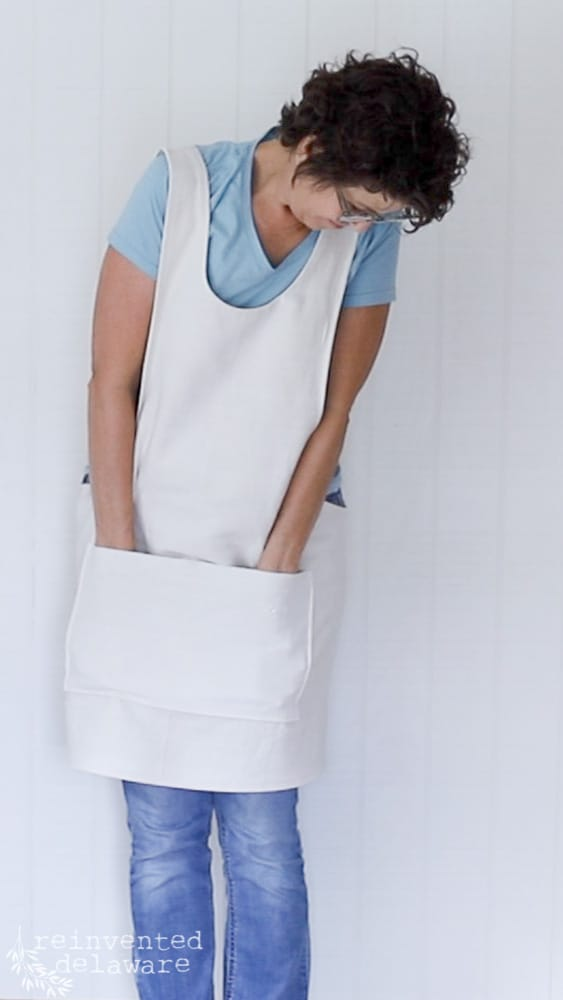 lady modeling an apron she sewed herself