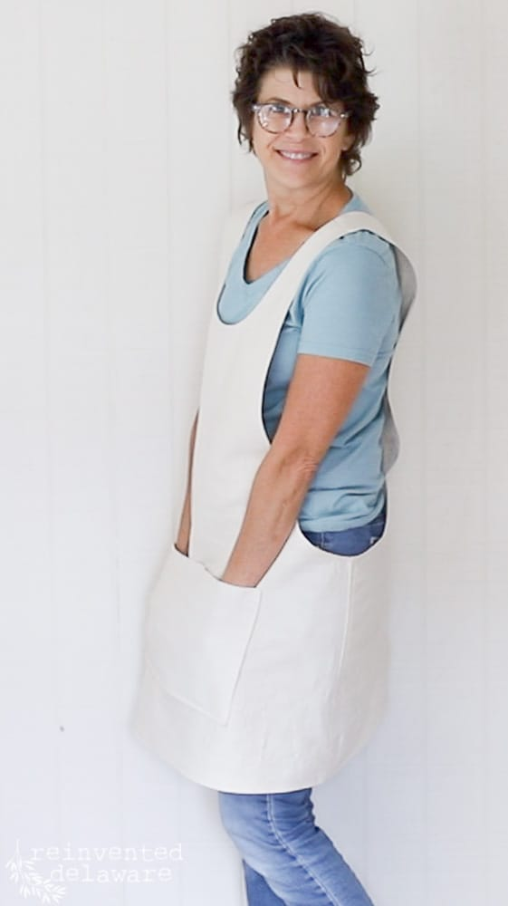 lady modeling an apron made for how to sew an apron blog post