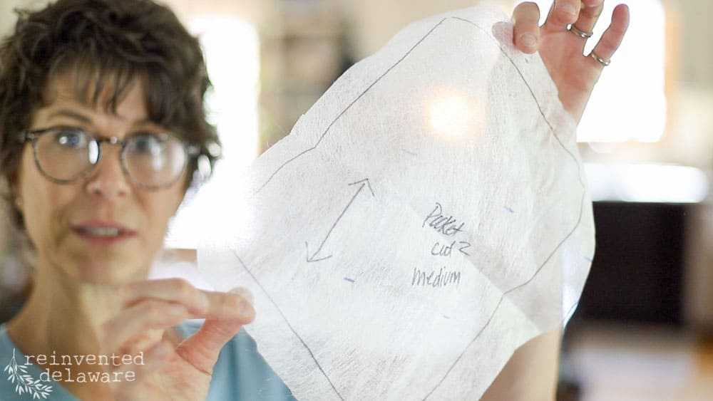 lady showing pattern tracing material for sewing tutorial