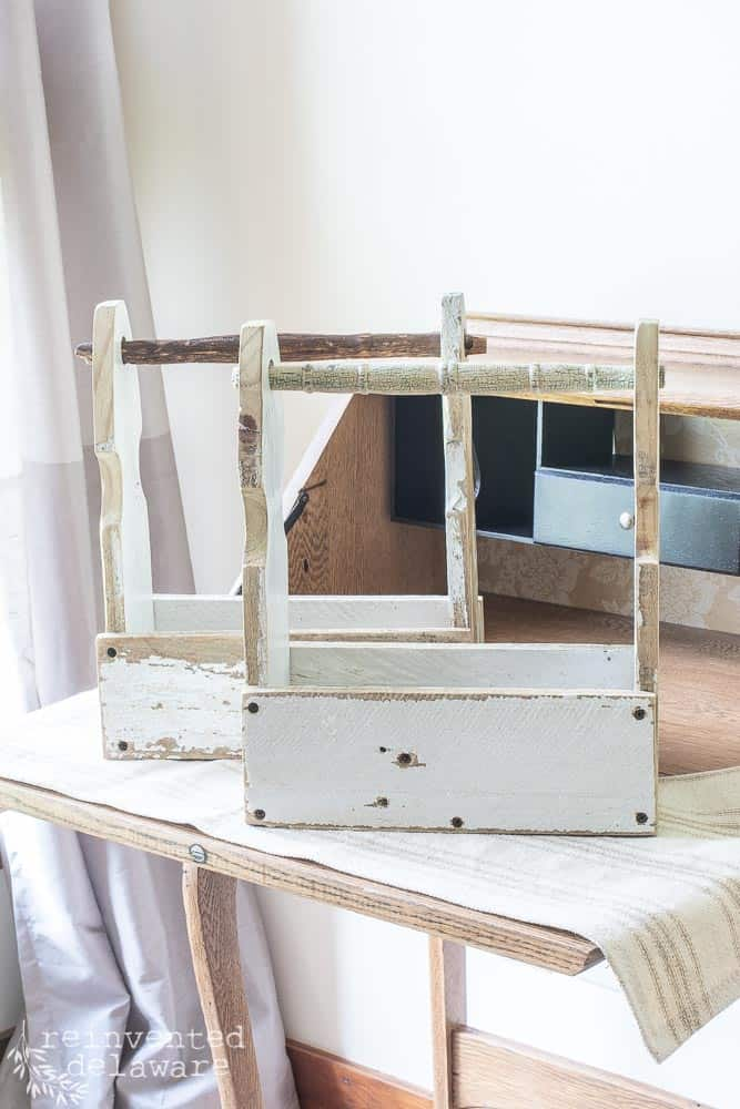 two fence picket crates sitting on top of desk