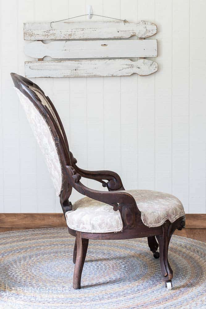 side view of antique victorian chair ready for reupholstery