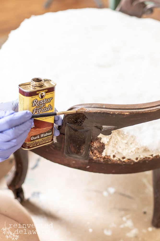 Howards Restor-A-Finish being applied to damaged wood on antique chair