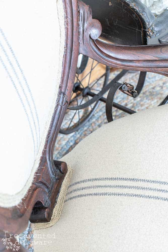 close up of carved wood frame on reupholstered chair