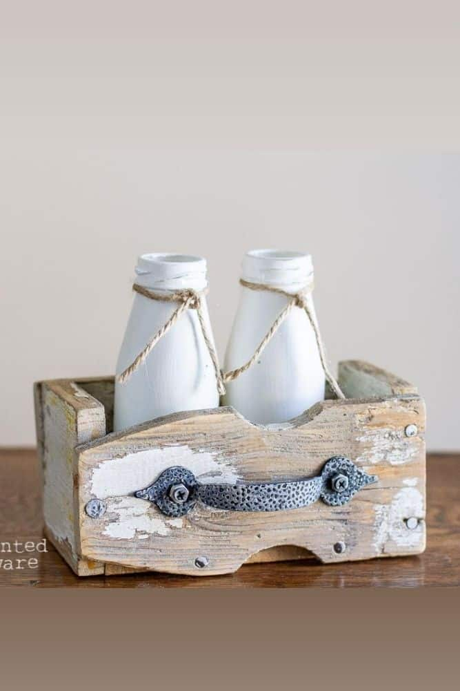 old fence picket projects - small box made from fence pickets with painted milk bottles and drawer pull on front