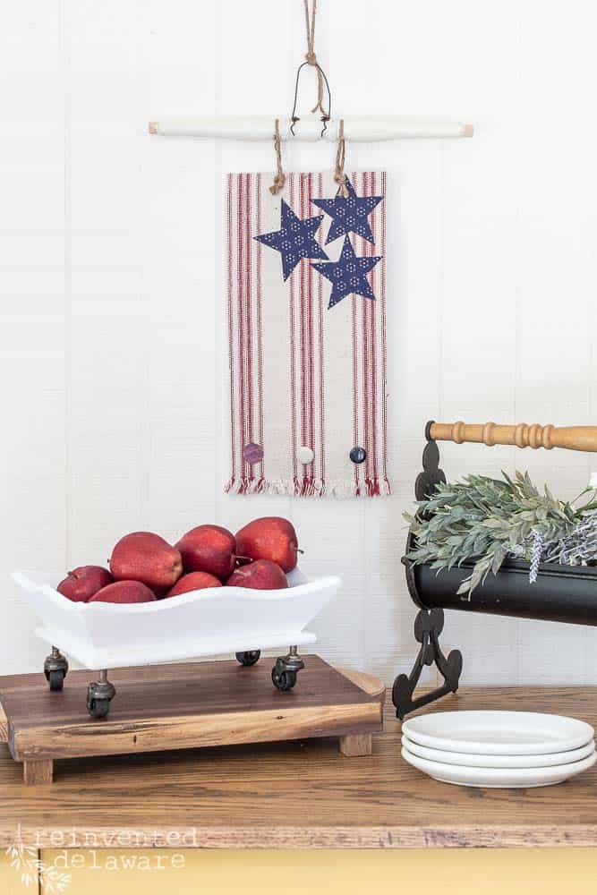 various repurposed home decor pieces staged together on top of table