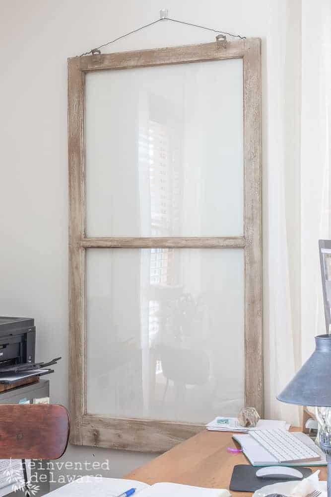 vintage window hanging on wall
