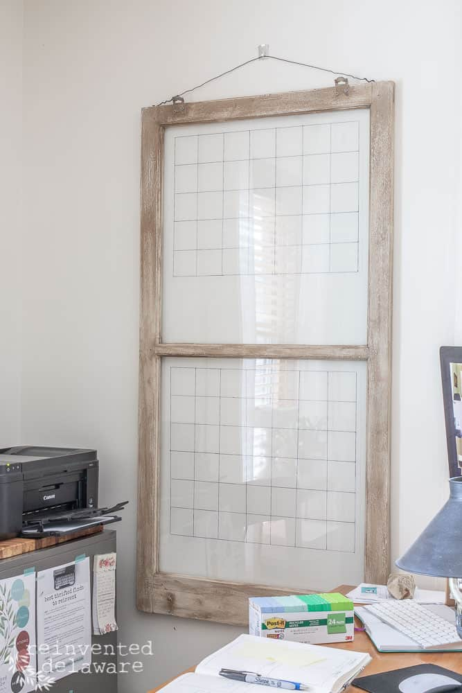 vintage window hanging on wall with grid lines on glass
