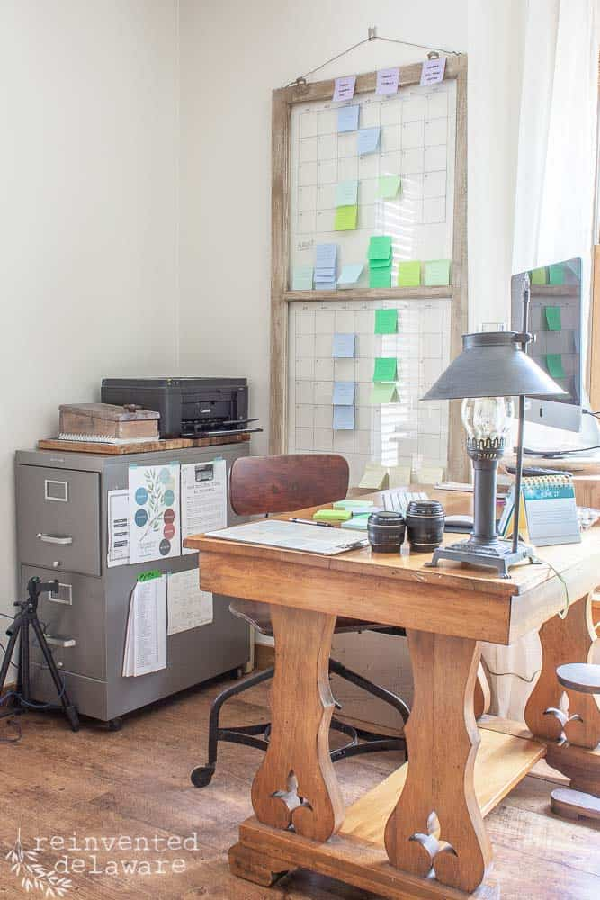 desk area for a blogger with content calendar made from a vintage window