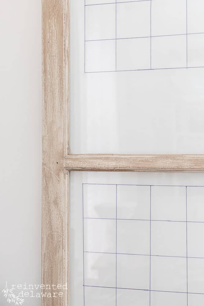 vintage window with grid lines marked on it