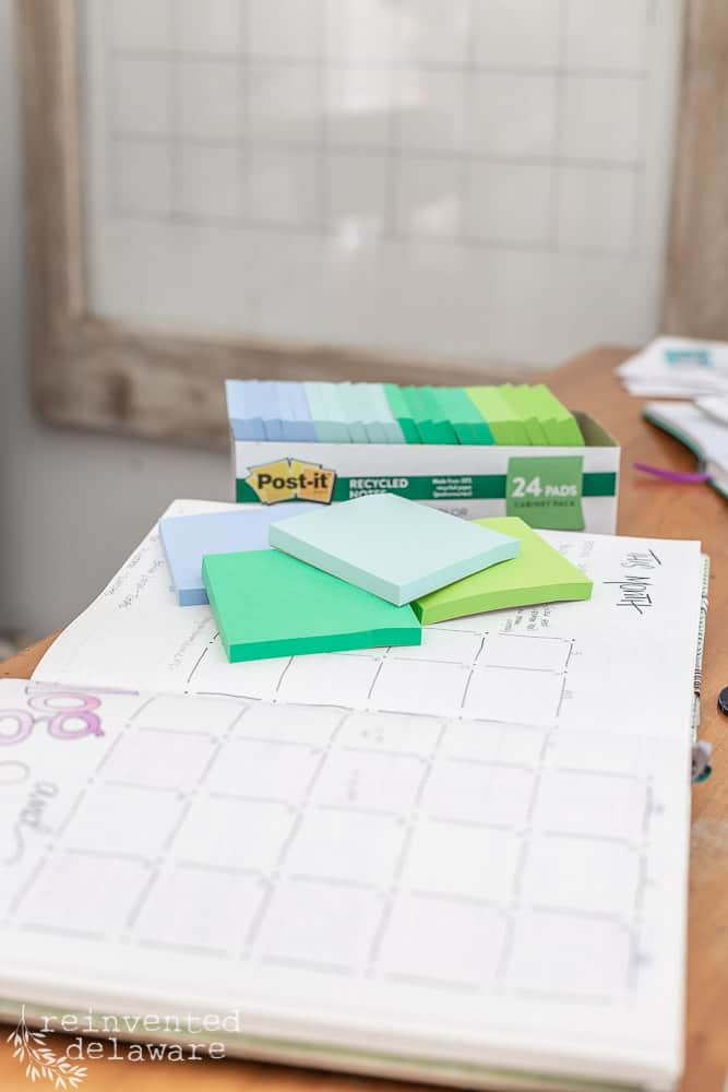 bullet journal notebook with post it notes stacked on top