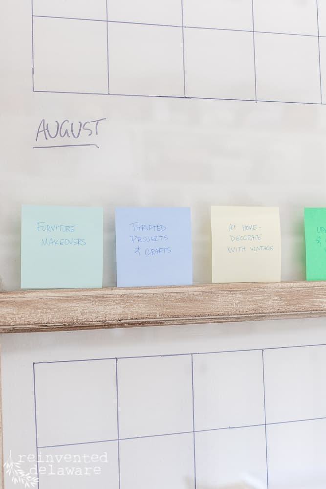 close up of antique window with post it notes being used for content calendar