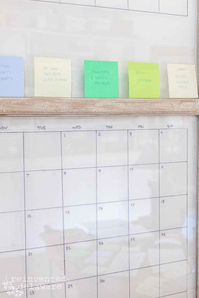 close view of vintage window with grid marked for a blogging content calendar