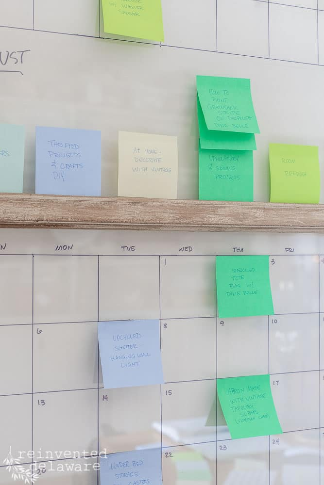 post it notes on a vintage window used as a large content calendar for bloggers and YouTubers