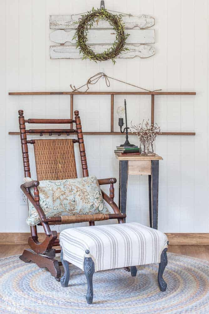 finished farmhouse style upholstered footstool staged with rocker and wall decor
