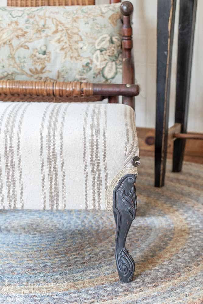 detail shot of painted leg on farmhouse style upholstered footstool