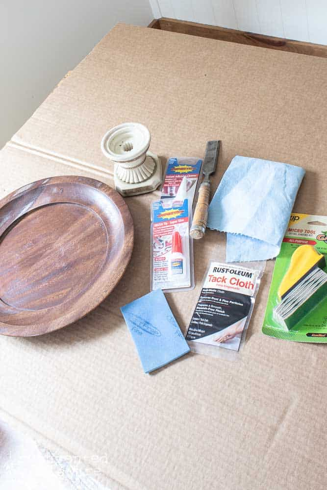 supplies on surface for thrift store home decor tutorial