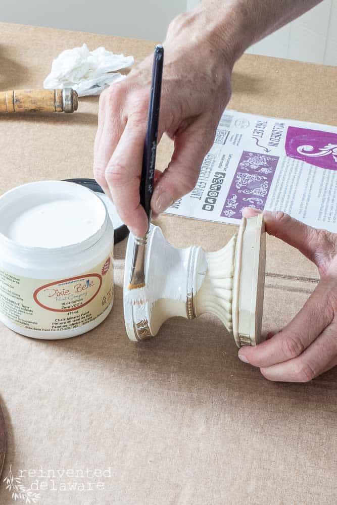 lady painting small candle holder using Dixie Belle Chalk Mineral paint